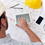 """Planung und Entwicklung im Bauwesen - Architekt mit Tablet und techn. Zeichnung am Arbeitsplatz"""""""